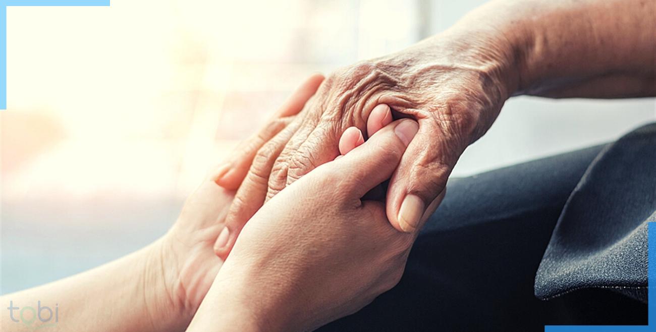 patients holding hands